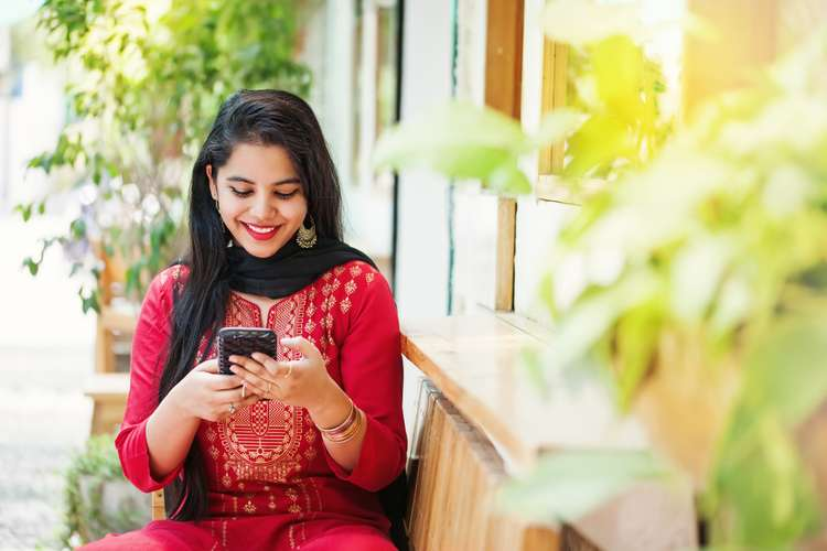 A woman using smartphone.